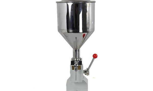 Kleine handbediende crème-vulmachine